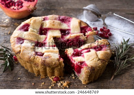 Sliced homemade tart cake stuffed with pomegranate jam,selective focus  - stock photo