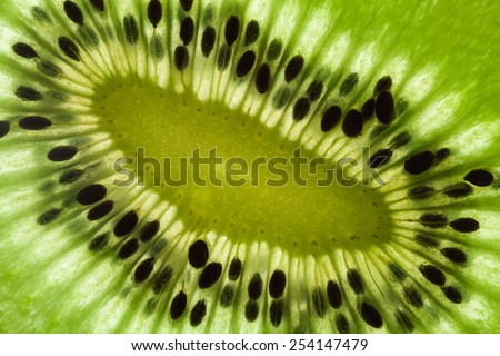 Sliced kiwi texture close up - stock photo