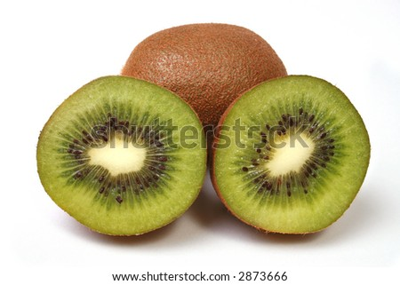 Sliced kiwi with unsliced behind it isolated on white. - stock photo