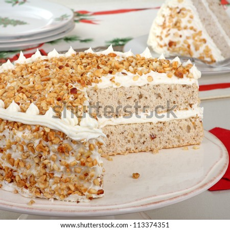 Sliced layer cake on a cake plate - stock photo