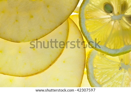Sliced Lemon and Apple isolated on white with backlight