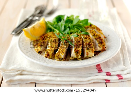 Sliced lemon herb crusted chicken breast - stock photo