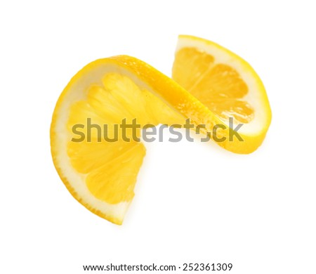Sliced lemon isolated on white - stock photo