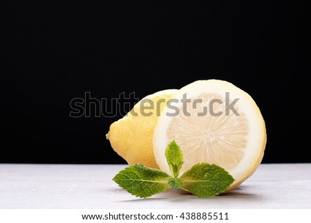 sliced lemon on the table on a dark background - stock photo