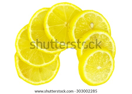Sliced lemon on wheels arranged in a semicircle - stock photo