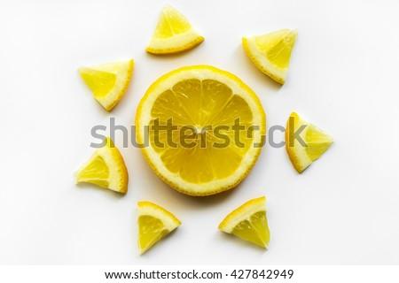 Sliced lemon on white background. Sun symbol.  - stock photo