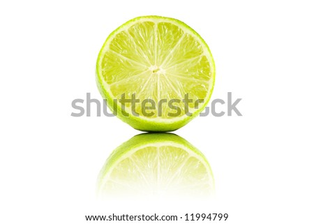 Sliced lime fruit with reflection isolated - stock photo