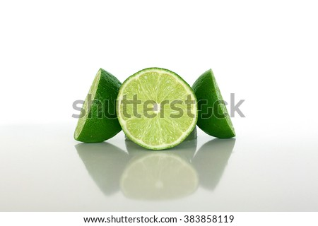 Sliced Limes Electric Green - stock photo