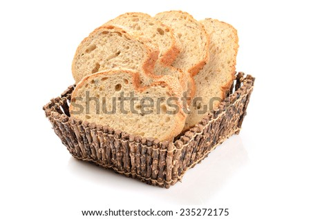 sliced loaf of bread in a basket isolated on white - stock photo