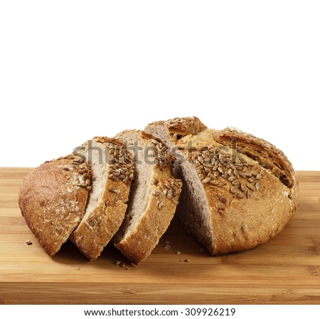 Sliced loaf of bread on a cutter board isolated on white - stock photo