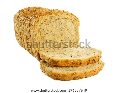 Sliced loaf of bread with toppled pieces over a white background                    - stock photo