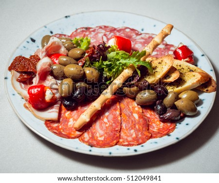 sliced meat with various additions on a plate