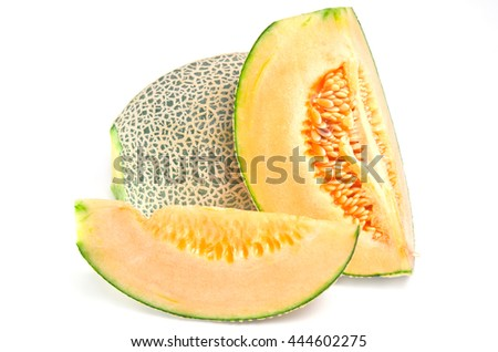 Sliced melon with seed on wooden board (Other names are Melon, cantelope, cantaloup, honeydew, Crenshaw, casaba,  Persian melon, and Santa Claus or Christmas melon) - stock photo