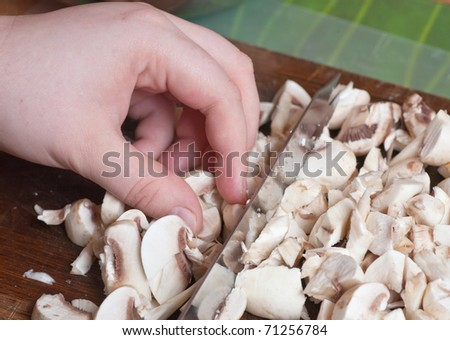 sliced mushrooms and onions on a cutting board