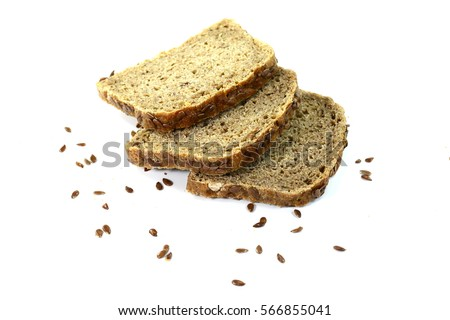 sliced of black bread with linseed isolated on white background