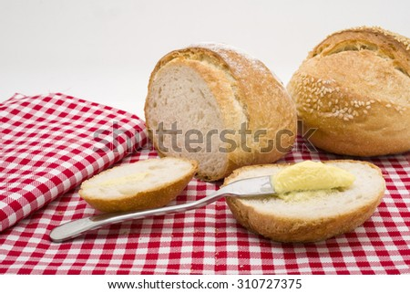 Sliced of round bread with butter. - stock photo