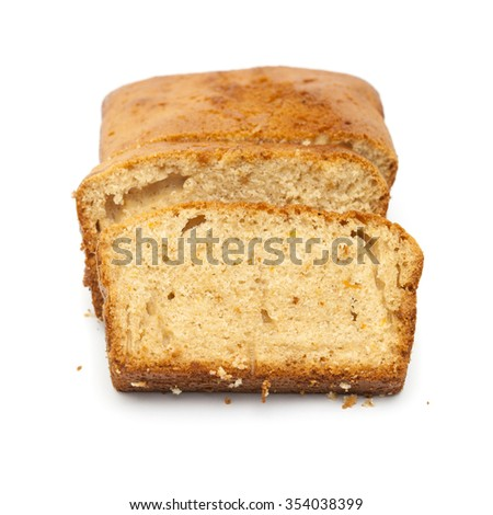 sliced orange and cinnamon cacke isolated on white background