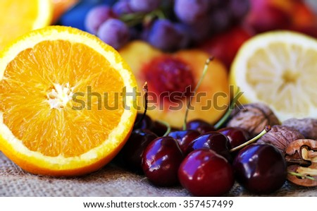 sliced orange and fruits on table - stock photo