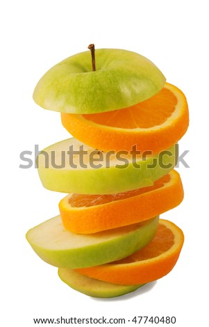 Sliced orange and green apple isolated over white background
