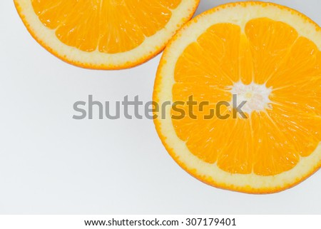 sliced orange fruit isolated on blue background, pop art color concept - stock photo