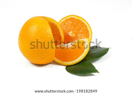Sliced orange fruit with green leaves on white background - stock photo