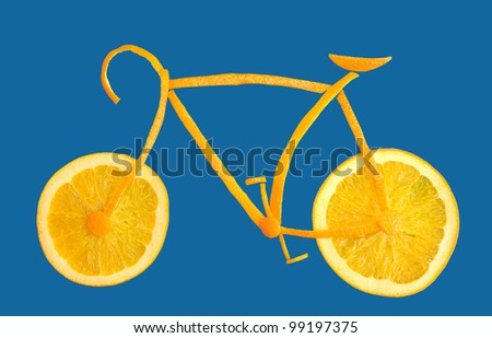 sliced orange in form of a bicycle