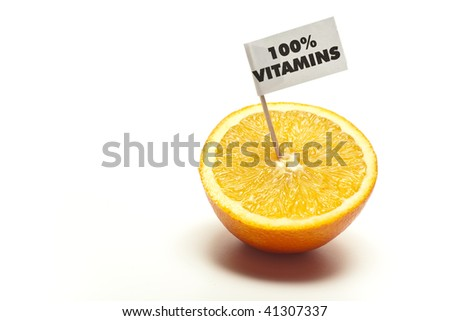 "sliced orange with flag ""100% vitamins"" in front of white background"