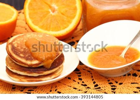 Sliced oranges and orange jam - stock photo