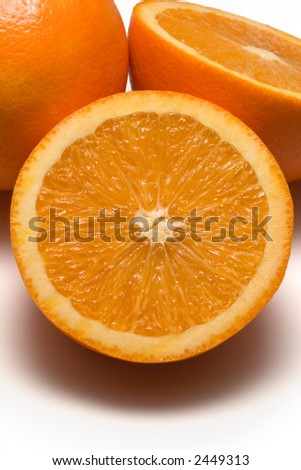 Sliced Oranges. Close-up of sliced oranges on white surface. - stock photo