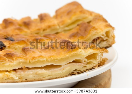 Sliced pastry with cheese and meat.