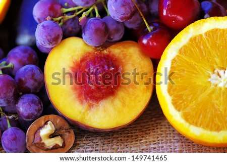 Sliced peach and orange, fruits on table - stock photo
