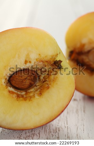 sliced peach on an old wooden background.