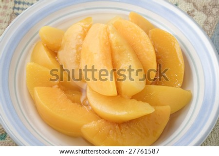 Sliced peaches in bowl ready to serve or eat - stock photo