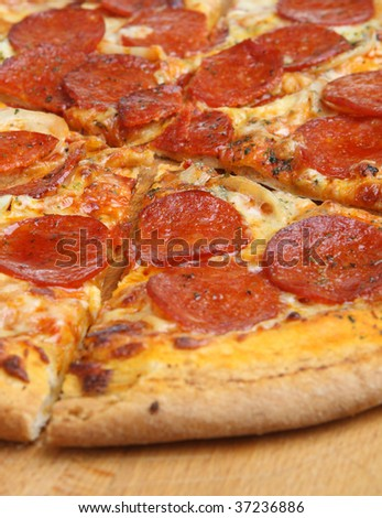 Sliced pepperoni pizza - stock photo