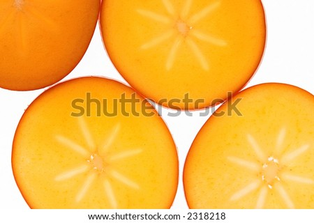 Sliced persimmon fruits isolated against a white background - stock photo