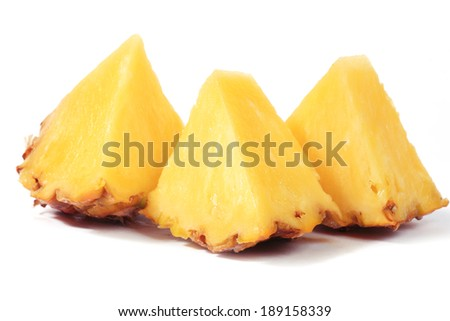 Sliced pineapple isolated on white/macro