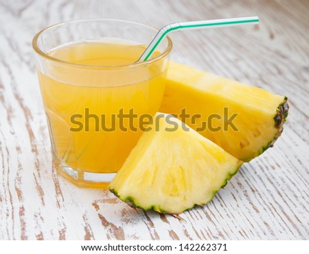 sliced pineapple with a glass of pineapple juice - stock photo