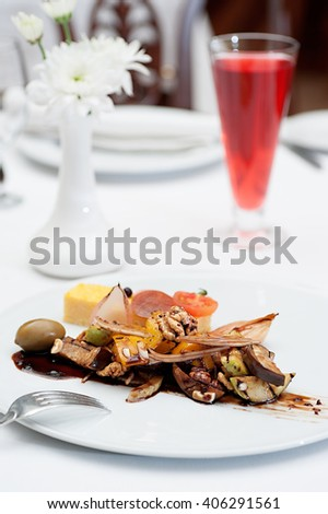 Sliced Polenta Cornmeal Served on a Restaurant Table with  a Glass of Fruit Drink - stock photo