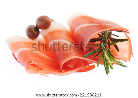 Sliced prosciutto with rosemary and olives on white background  - stock photo