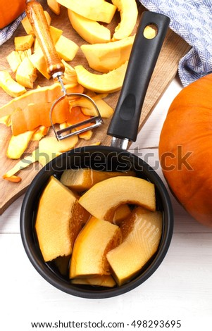 sliced pumpkin prepared in a pot with cold water