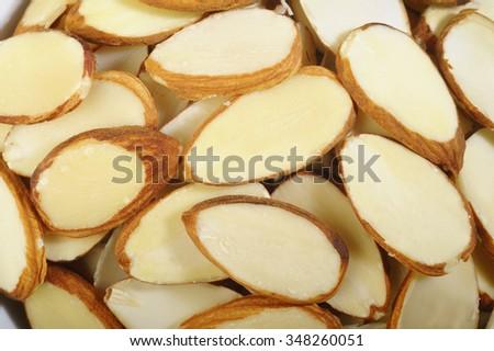 Sliced raw almonds - stock photo