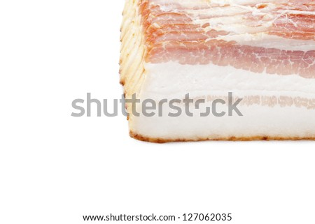 Sliced raw bacon in a row displayed on white background. - stock photo