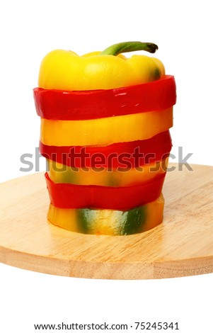 Sliced red and cutting board sweet peppers on a cutting board
