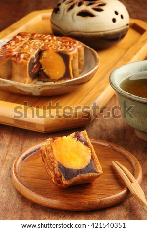 Sliced red bean paste moon cake with yolk          - stock photo