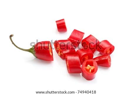 Sliced red hot chilli pepper over white background - stock photo