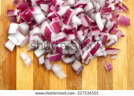 Sliced red onion on wooden background  - stock photo