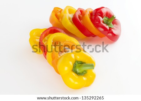 sliced red yellow orange pepper isolated on a white background - stock photo