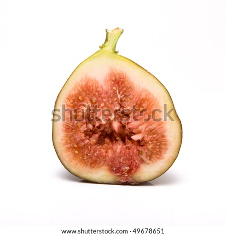 Sliced ripe fig from low viewpoint isolated against white background. - stock photo