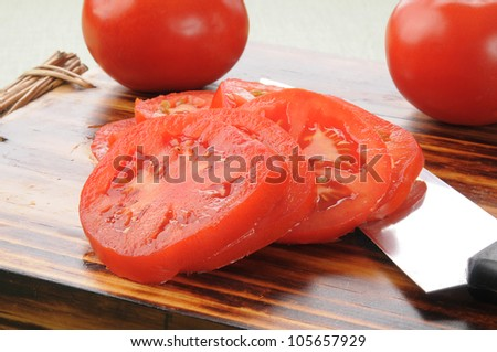 Sliced ripe juicy tomatoes on a cutting board