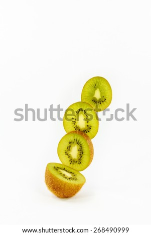 Sliced ripe kiwi on a white background - stock photo